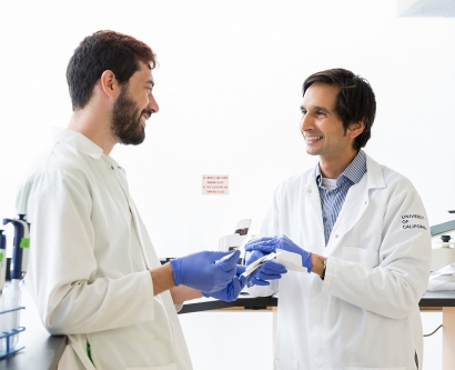 Bassem Al-Sady talks with Nick Sanchez in a lab