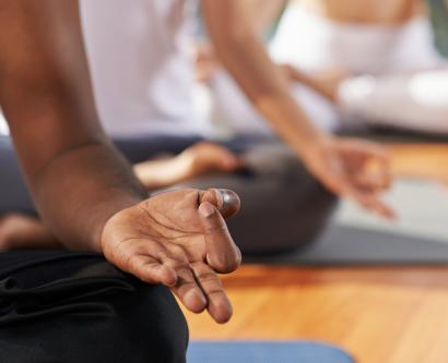 People meditating in lotus position.