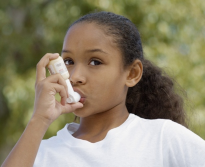 Young girl using an inhaler