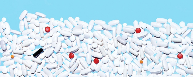 white pills against a blue background