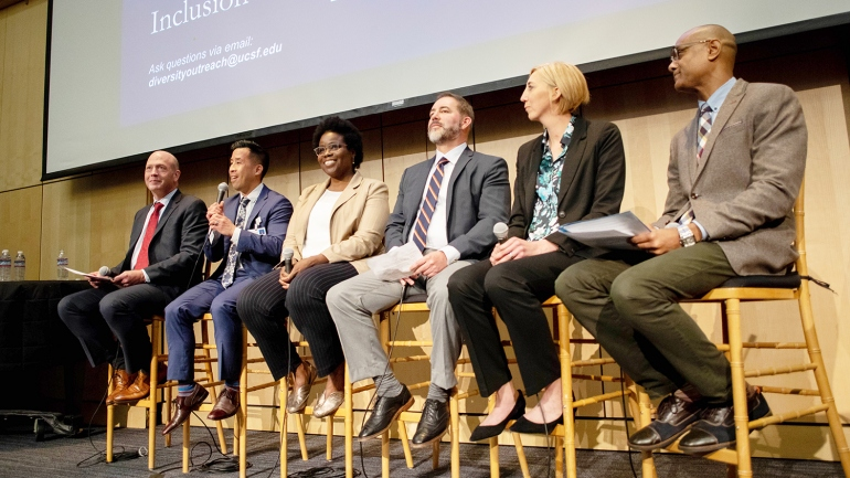 Paul Jenny, Jeff Chiu, Nancy Duranteau, Sergio Saenz, Leeane Jensen, and Roger Mohamed sit on a panel for the Chancellor's Leadership Forum on Diversity and Inclusion