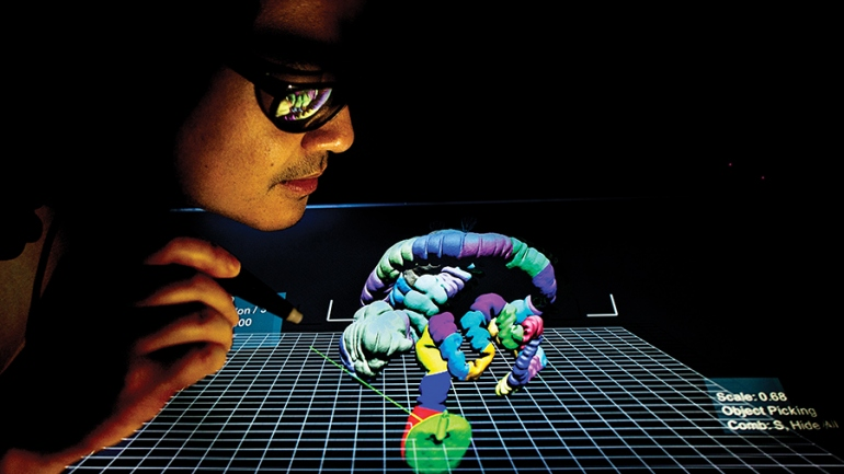 Donald Chau manipulating a 3-D illustration of a colon