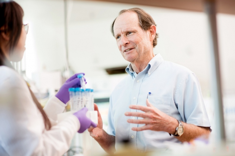 Bernard Halloran talks to a researcher in his lab