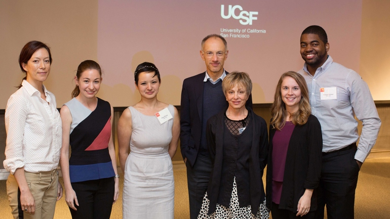 Christine Moore Sheridan, Amy Jacobson, Amy Chang, Sir Michael Moritz, Harriet Heyman, Meghan Zubradt and D'Juan Farmer stand during the Discovery Fellows Symposium