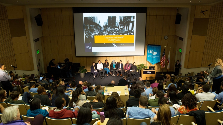wide view of a packed Cole Hall auditorium during the teach-in