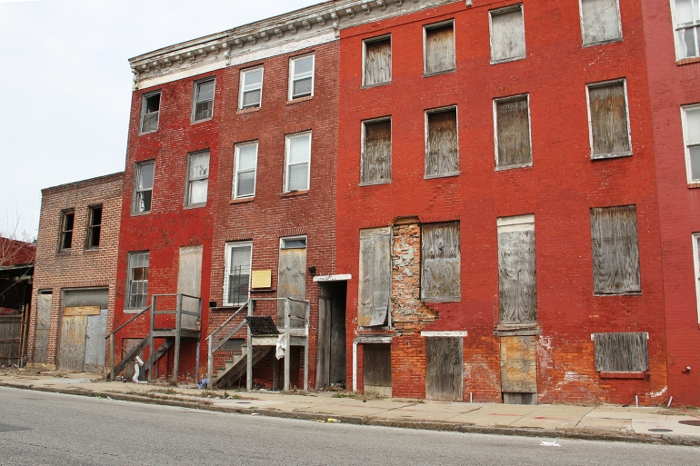 a boarded-up-building in Baltimore