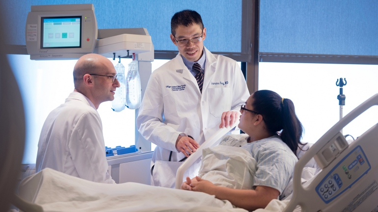 Lawrence Fong, MD, center, is shown in the new Cancer Immunotherapy Clinic consulting with Gabriel N. Mannis, MD, right, and a patient.