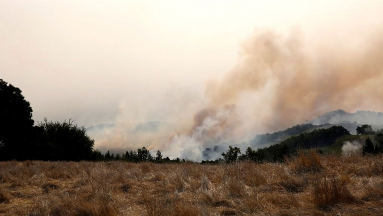 a wildfire burns in the hills of Napa Valley