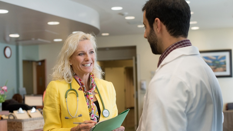 Pamela Munster, co-leader of the new UCSF Center for BRCA Research, speaks with Protocol Project Manager Kamran Abril Lavasani at the Helen Diller Family Comprehensive Cancer Center.