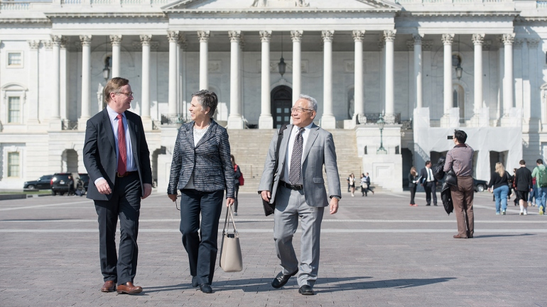 UCSF Chancellor Sam Hawgood, Vice Chancellor for University Relations Barbara J. French and Vice Chancellor for Science Policy and Strategy Keith Yamamoto walk in front of the US Capitol in Washington, D.C.