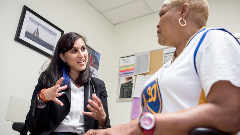 Neeta Thakur speaks with patient Elise Mims Edwards at Zuckerberg San Francisco General