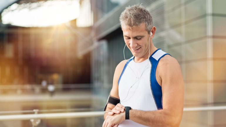 stock image of mature man taking a break from jogging
