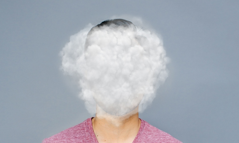Researcher's face clouded by smoke