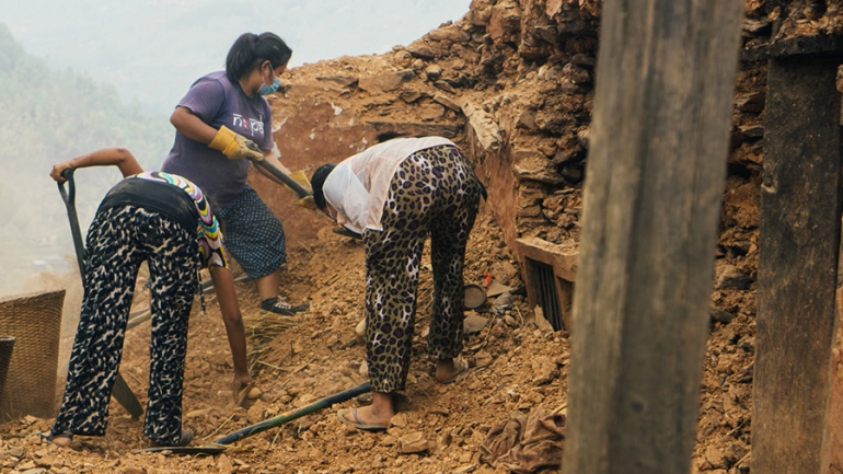 Three women digging with shovels in Nepal