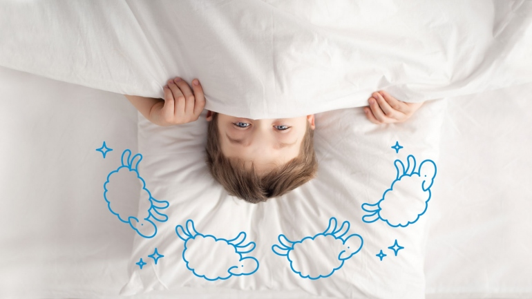 illustration of boy in bed with sheep jumping over his head