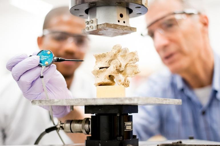 Jeffrey Lotz and Devante Horne examine a vertebra
