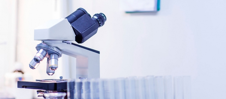 stock image of a microscope in a lab