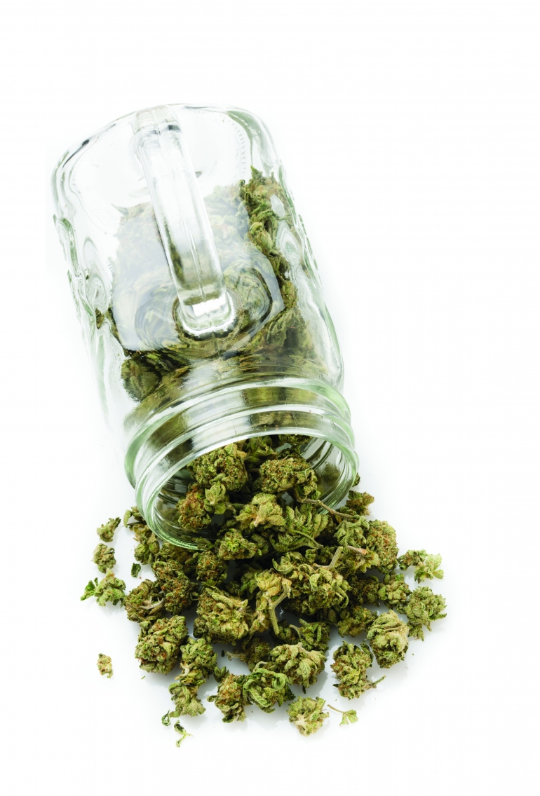 Weed spilling from jar