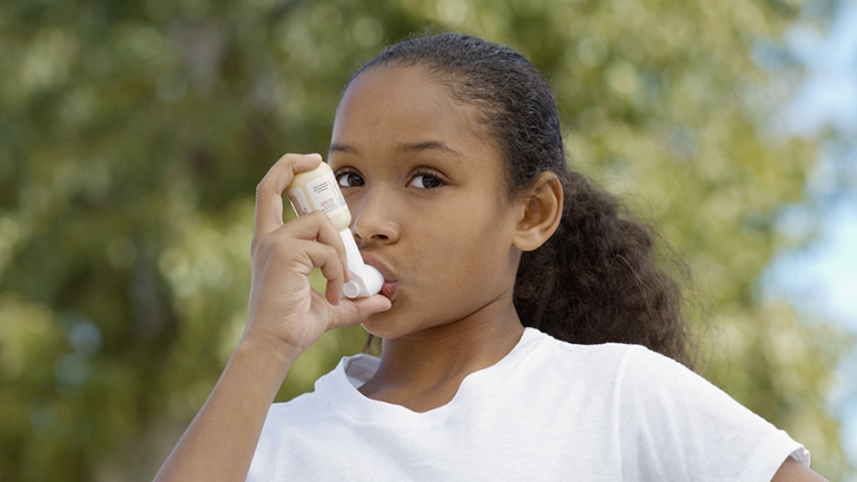 Young girl with an inhaler