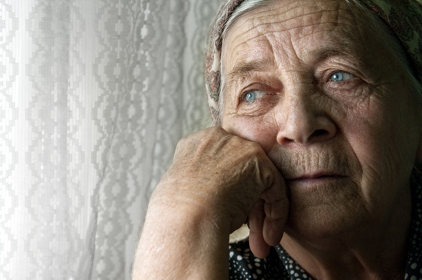 Elderly woman looking forlorn