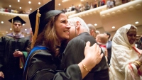 School of Medicine graduate hugs a loved one