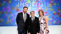 Sean Parker, UCSF immunologist Jeffrey Bluestone and journalist Katie Couric stand in front of a sign annoucing the new Parker Institute for Cancer Immunotherapy during an event in Los Angeles