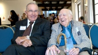 Jack Stobo, executive vice president of UC Health, shares a laugh with Ephraim Engleman at a mentoring event in 2012