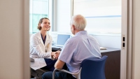 stock image of female doctor greeting a patient in her office