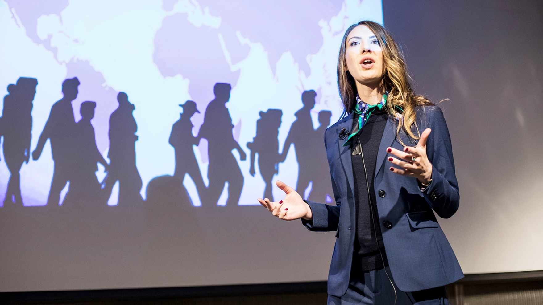 Meredith Van Natta delivers her talk during the 2018 Grad Slam competition