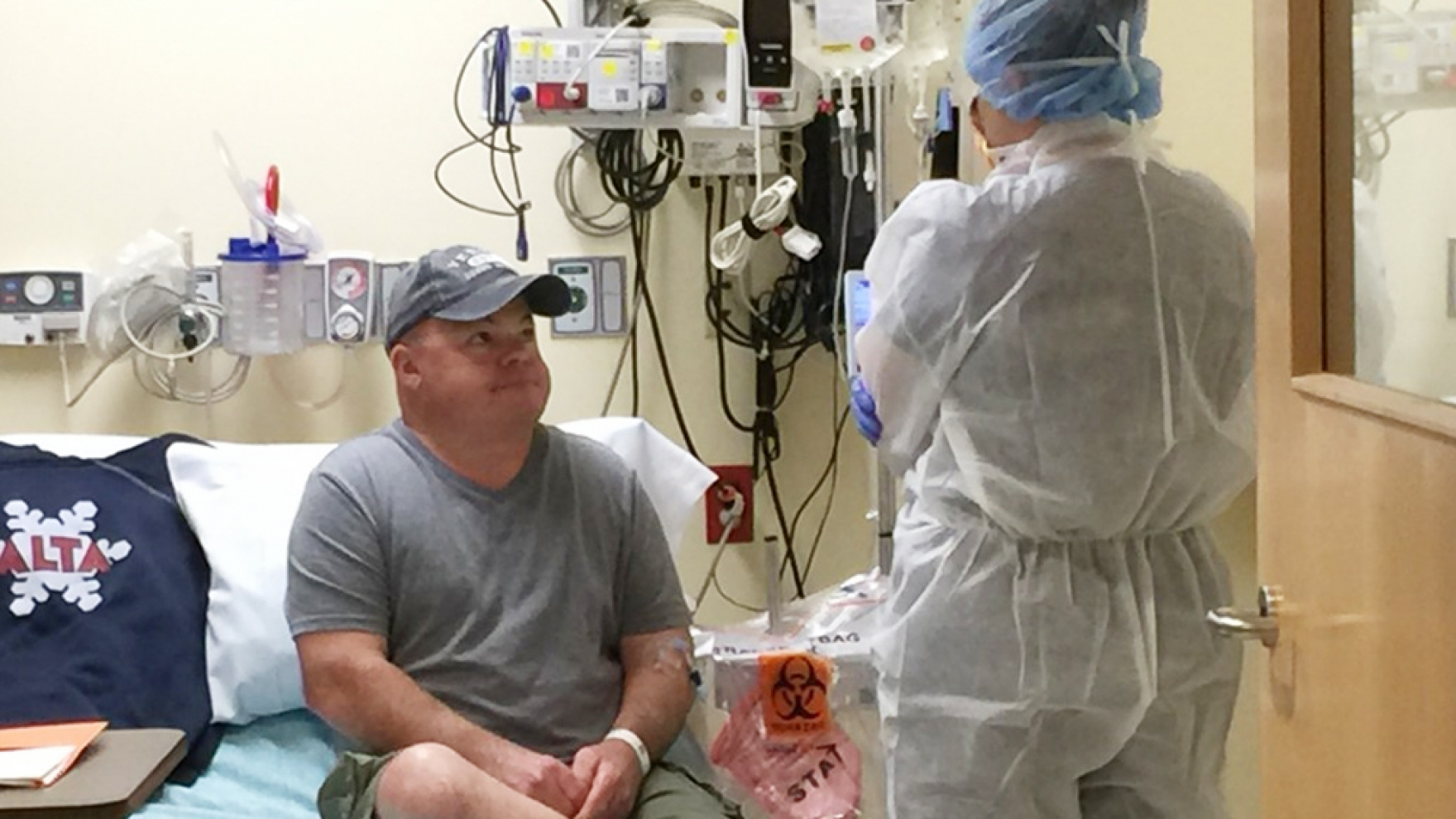 Brian Madeux receives an infusion of a gene-editing therapy meant to fix an error in his DNA