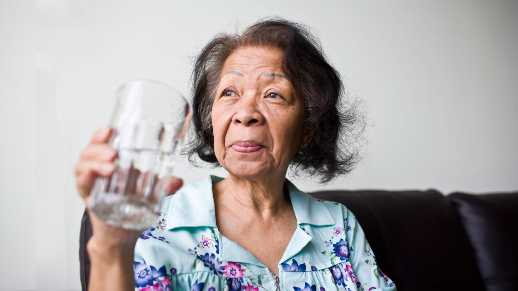 stock image of senior African American woman looking out the window