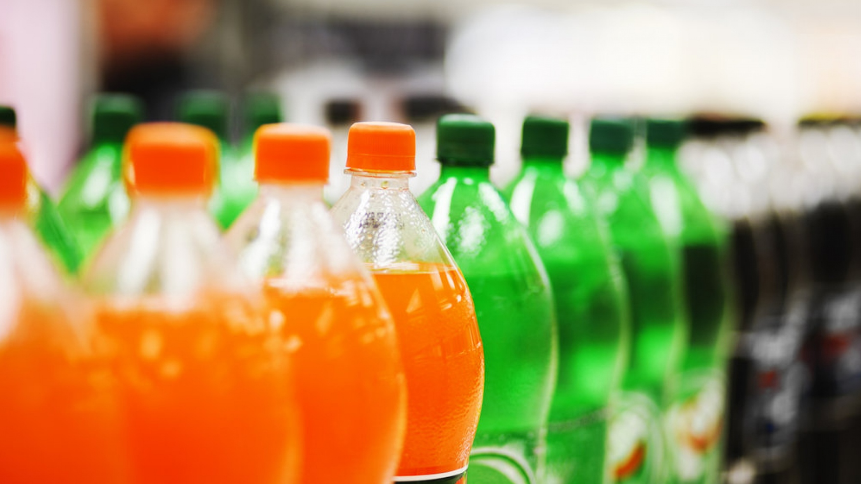 soda bottles on a supermarket shelf