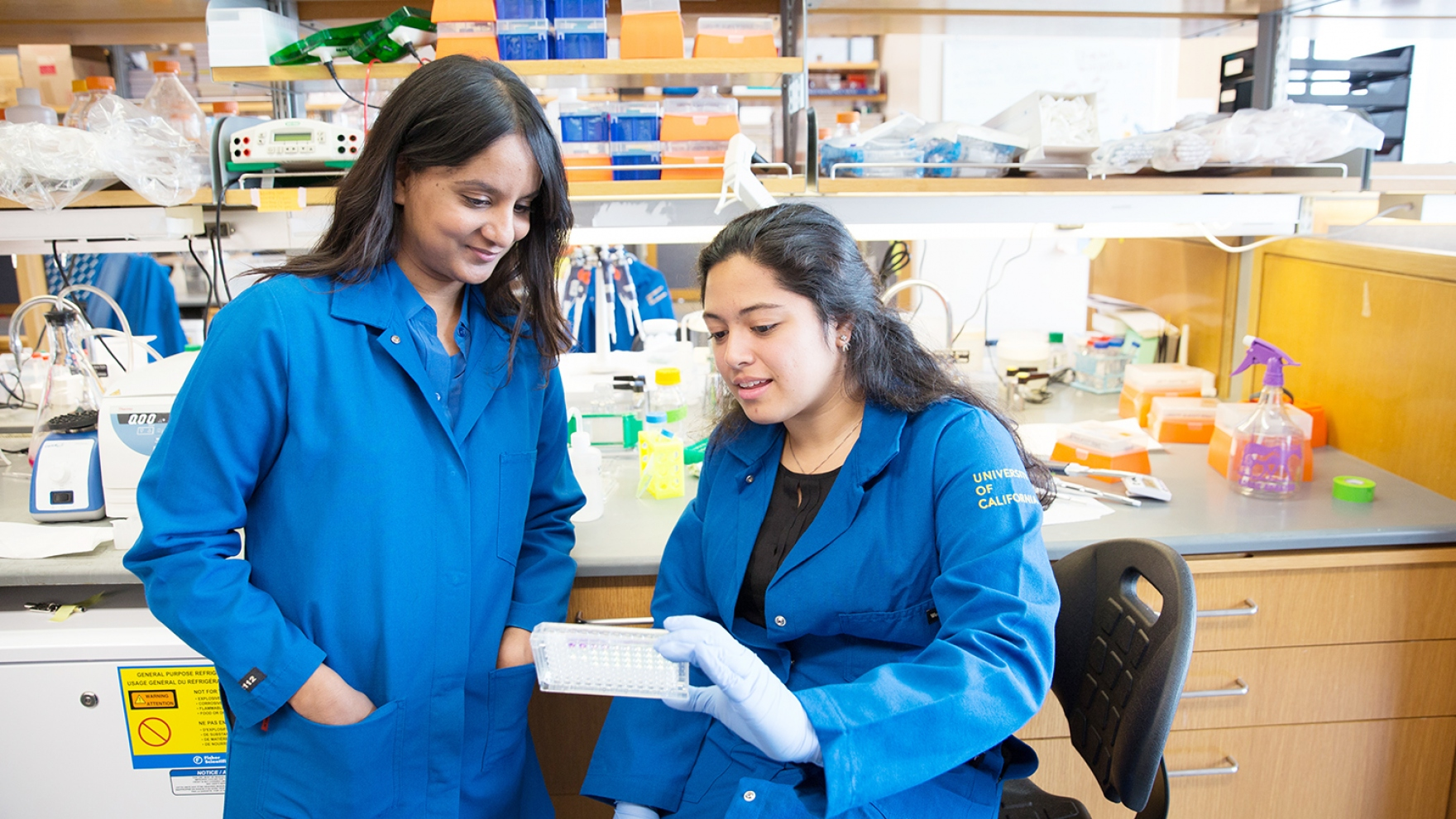 Rushika Perera and Andrea Eastes work in Perera's lab