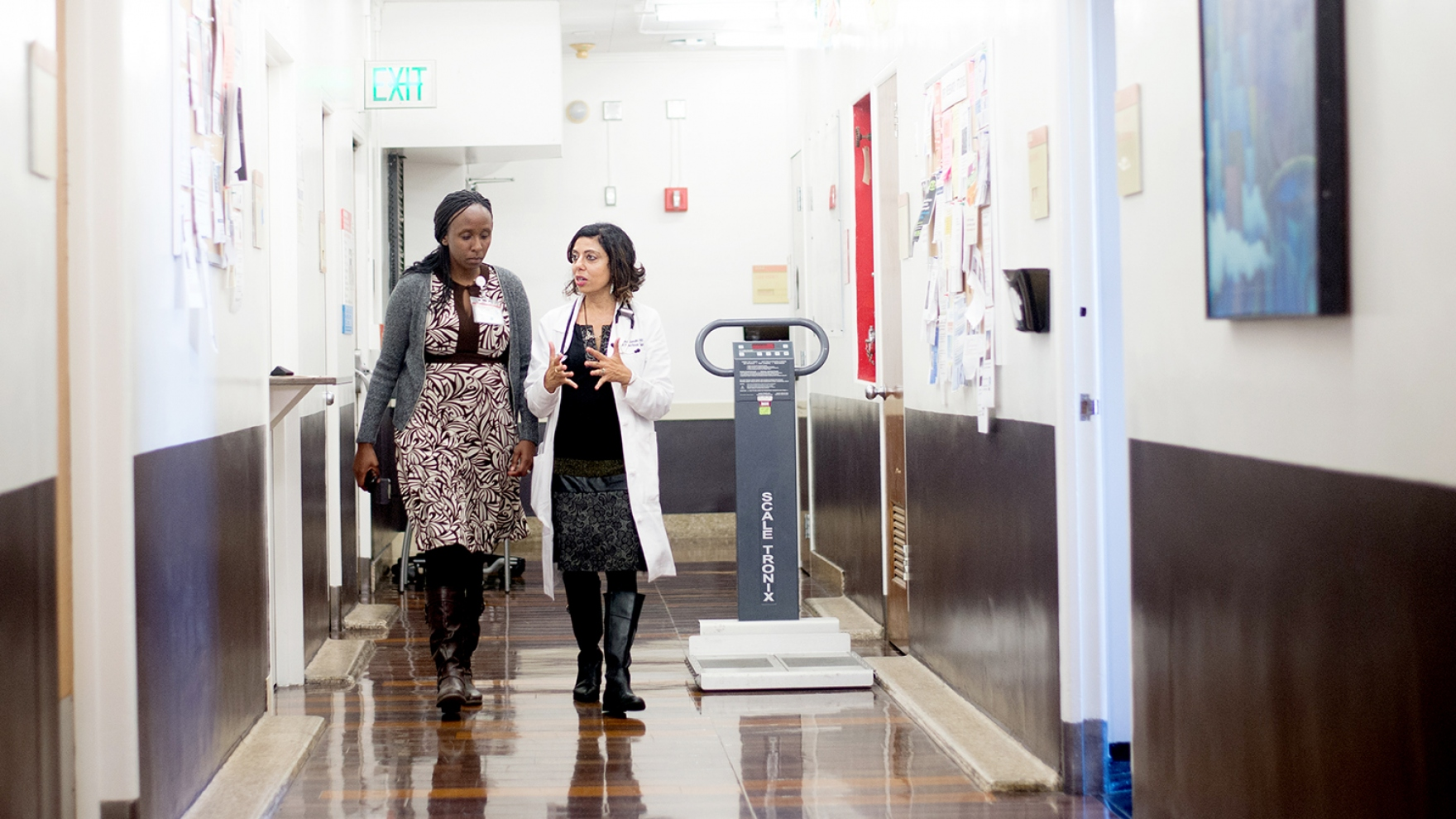Monica Gandhi talks with a patient in Ward 86 at Zuckerberg San Francisco General