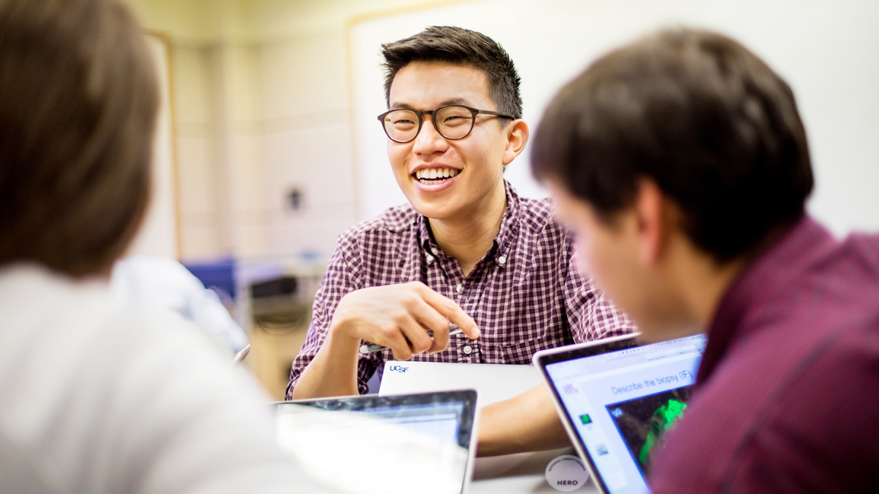 Nathan Kim studies with fellow students at UCSF's library
