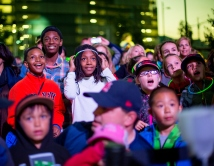 Children smile during the light show celebrating the upcoming opening of the new UCSF Medical Center at Mission Bay.