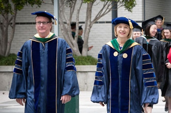 Sam Hawgood and Susan Desmond-Hellmann walk to the 2012 School of Medicine commencement ceremony.