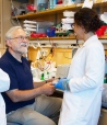 Peter Walter in his lab with visiting postdoc Pelin Telkoparan and postdoc Silvia Ramundo.