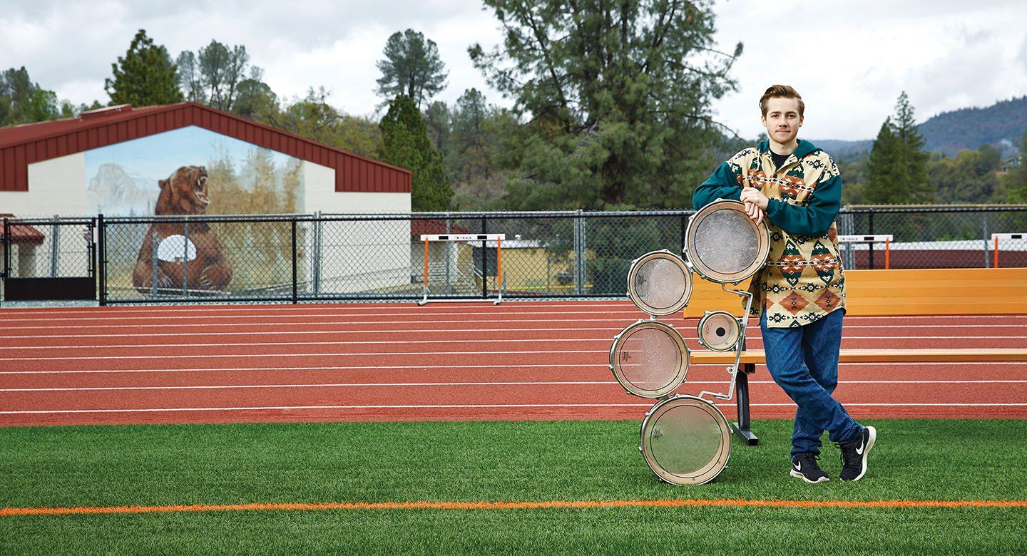 Oliver Bishop with drumline equipment