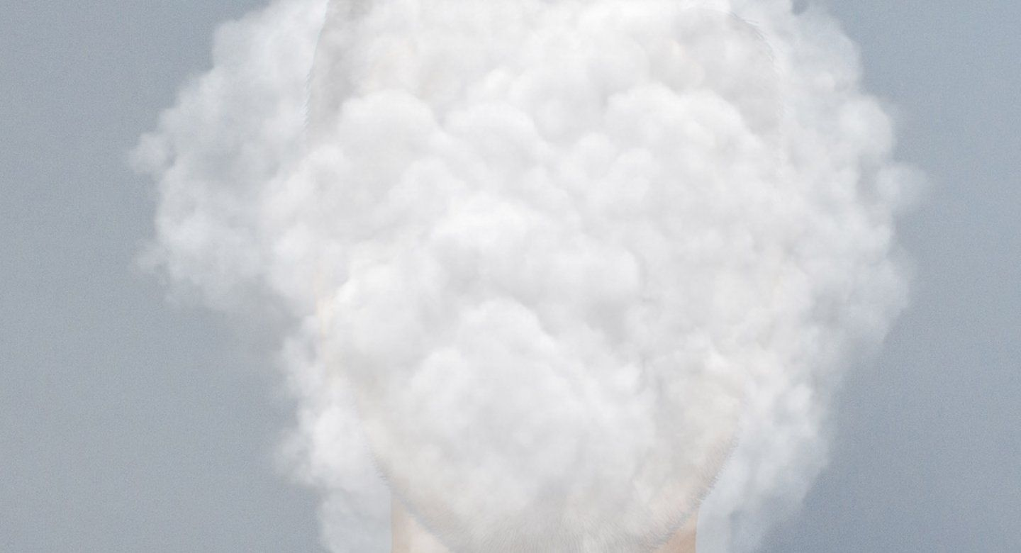 Face in cloud of smoke