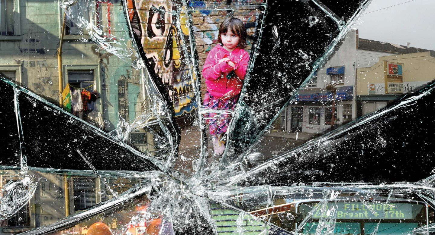 Scenes of poverty split by a broken pane of glass