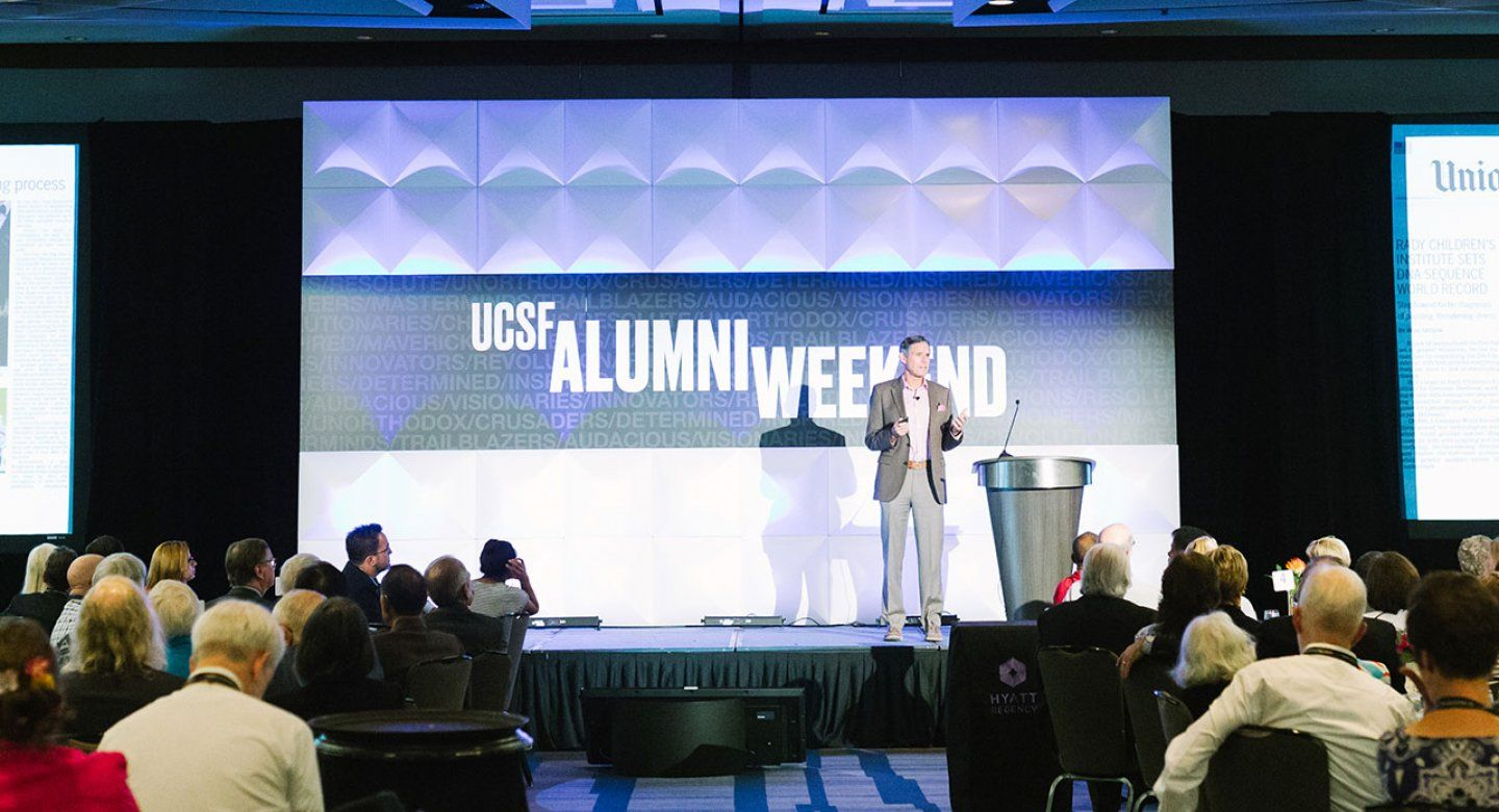 man on stage at UCSF Alumni Weekend