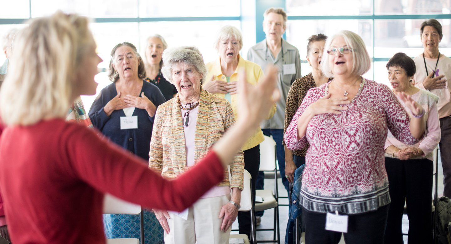 Community choir members singing
