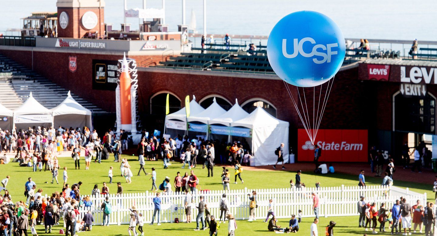 a balloon with UCSF logo over Oracle Park field