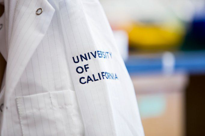 "Lab coat with ""University of California"" on sleeve"