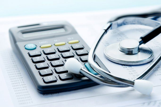 calculator-stethescope-hospital-bill-costs.jpg