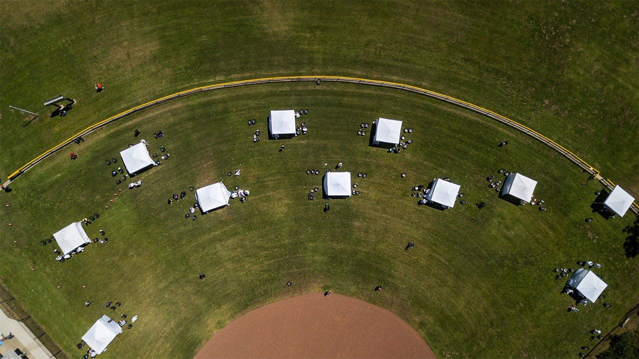 An aerial view of a baseball field with tests set up for a COVID-19 testing site in San Francisco's Sunnydale neighborhood.