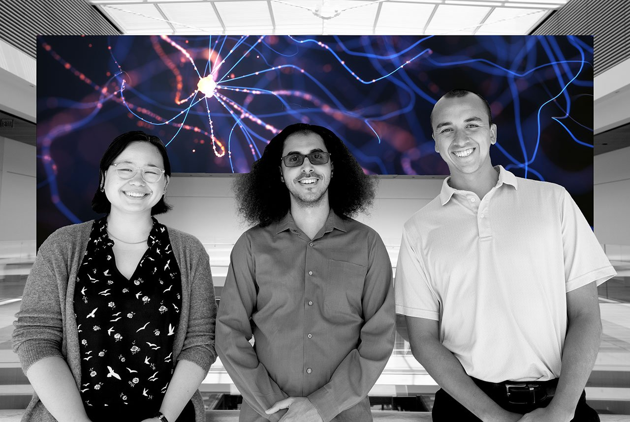 Three researchers who participated in the Bravo study side by side over a neuron background