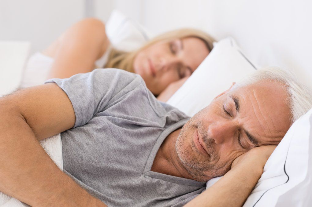 a photo of an older man and woman sleeping