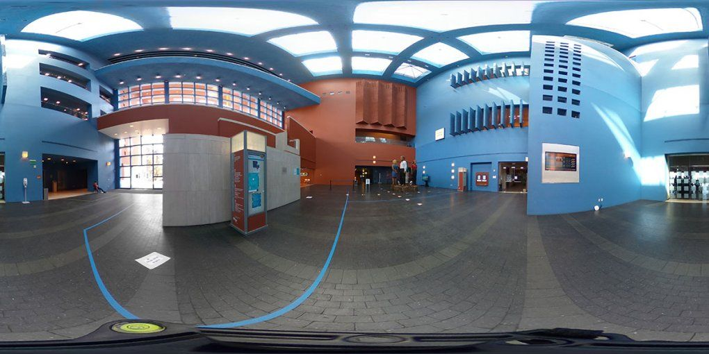 The lobby of the Rutter Center showing skylights far overhead and geometrical blue and orange walls